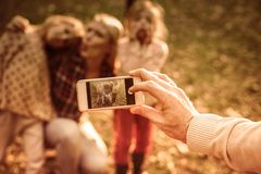 Making memories. Father taking photo of his family. Close up royalty free stock photos