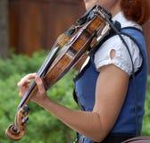 Making Merry. Woman playing violin Royalty Free Stock Photo