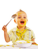 Baby enjoying his lunch Royalty Free Stock Photo