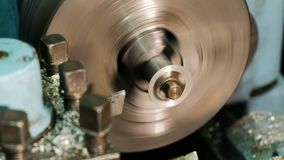 Making a metal part on a lathe.  stock footage