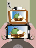 Making microstock with simple lightbox and camera phone. Taking coconut image by using phone and lightbox Stock Photo