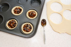 Making mince pies in the kitchen Stock Image