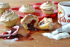 Making of mini cup cakes. Mini cup cakes with jam filling and a merengue topping in the making Royalty Free Stock Image