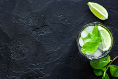 Making mojito on dark background top view.  Royalty Free Stock Image