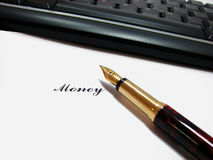 Making money. Pen on paper with inscription money and keyboard Royalty Free Stock Photos