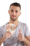 Making Money. A handsome man has made some money. All isolated on white background Stock Image