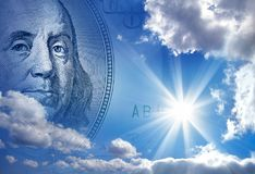 Making money concept. Conceptual image of one hundred US dollar bill in blue sky stock image