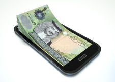Making money with e commerce using smartphone Royalty Free Stock Photo