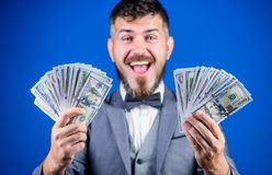 Making money with his own business. Bearded man holding cash money. Rich businessman with us dollars banknotes. Currency. Broker with bundle of money. Business stock images