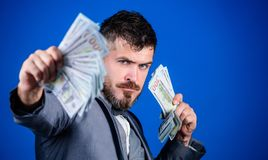 Making money with his own business. Rich businessman with us dollars banknotes. Currency broker with bundle of money. Bearded man holding cash money. Business stock photo