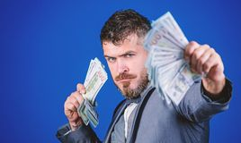 Making money with his own business. Rich businessman with us dollars banknotes. Currency broker with bundle of money royalty free stock photo