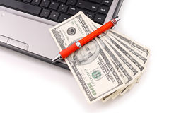 Making Money Online. Pen on Hundred Dollar Bills Stock Photography
