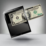 Making Money. With a Touch Pad Tablet Royalty Free Stock Photo