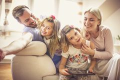 Making the most of family time with smart technology . Happy young family enjoying at home. Close up royalty free stock image