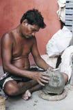 Making Of Mother Doddess. An artist of Kumartuli from Kolkata making a clay idol of goddess Durga for the famous Durga puja festival.Kolkata,India. For stock photos