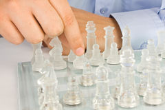 Making move on glass chessboard Stock Image