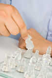 Making move on glass chessboard Royalty Free Stock Image