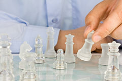 Making move on glass chessboard Royalty Free Stock Images