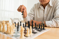 Making move. Man making clever move with black pawn Stock Image