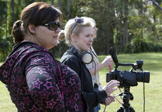 Making movies 4. Female movie makers, filming a project outdoors Royalty Free Stock Image