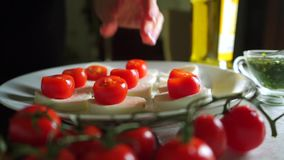 Making mozzarella and tomato salad Caprese . Part of the set stock footage