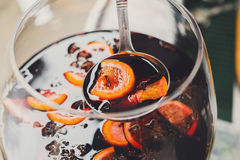 Making mulled wine for sale at country fair, closeup Royalty Free Stock Photo