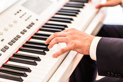 Making music. hand  playing the piano. Making music. hand man playing the piano Royalty Free Stock Photography