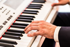 Making music. hand  playing the piano. Making music. hand man playing the piano Royalty Free Stock Images