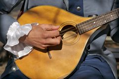Making Music II. Strolling troubadour playing vintage guitar royalty free stock photos