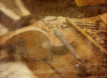 Making Music. Musical instruments on a luthier's workbench with a texture overlay of sheet music for a vintage artistic look Stock Photo