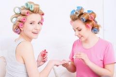 Making nail art at pajama party Stock Photography