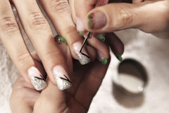 Making nails - applying gels and colors Stock Photo
