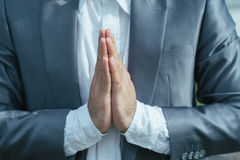 Making Namaste gesture. Close-up image of man making Namaste gesture with his palms royalty free stock photos