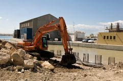 Making a new harbor with excavator Stock Photography