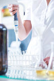Making new test tubes. Female scientist is making new test tubes Stock Photos