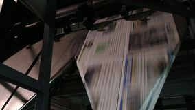 Making the newspaper of the day stock footage