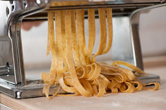Making noodles with pasta machine from homemade spelt dough. Stock Image