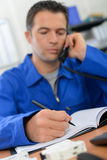 Making notes during call Stock Photo