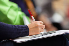 Making notes at conference, detail. Stock Photography