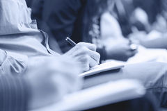 Making notes at conference, detail. Royalty Free Stock Images