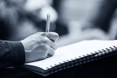 Making notes at conference, detail. Royalty Free Stock Photo