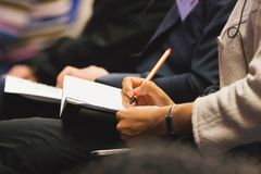 Making notes at the conference Royalty Free Stock Images