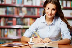 Making notes in library Stock Image
