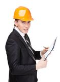 Making notes man in helmet. Making notes man in orange helmet and suit, isolated on white Royalty Free Stock Photography