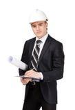 Making notes man in white headpiece. Making notes man in white headwear handing blueprint, isolated on white Stock Image