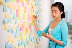 Making notes on the memo stickers Royalty Free Stock Photo