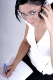 Making a notes from phone call Royalty Free Stock Photography