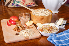 Making Oatmeal with Ingredients on Cutting Board Stock Photography