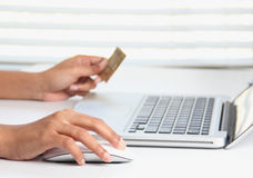 Making online purchase using a credit card. Making online purchase on a laptop using a credit card Royalty Free Stock Photography