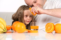 Making orange juice Stock Images